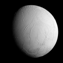 NASA's Cassini spacecraft captured this view as it neared icy Enceladus for its closest-ever dive past the moon's active south polar region. The view shows heavily cratered northern latitudes at top, transitioning to fractured, wrinkled terrain.