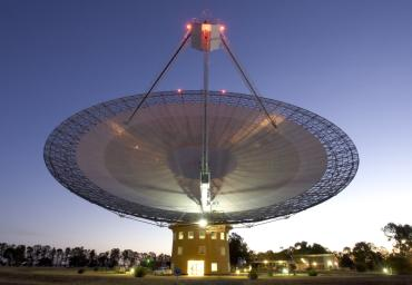 This image shows the Parkes telescope in Australia, part of the Commonwealth Scientific and Industrial Research Organization. Researchers used the telescope to detect the first population of radio bursts known to originate from beyond our galaxy.