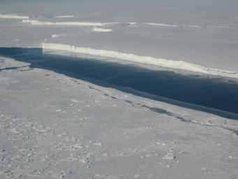 This photo, taken onboard the Chilean Navy P3 aircraft, shows the ice front of Venable Ice Shelf, West Antarctica, in October 2008. It is an example of a small-size ice shelf that is a large melt water producer.