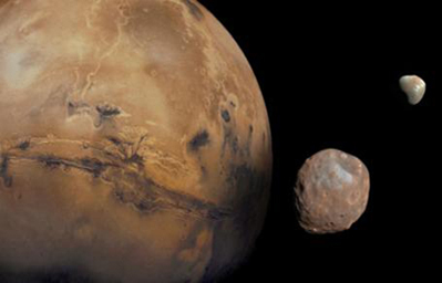 Mars is kept company by two cratered moons -- an inner moon named Phobos and an outer moon named Deimos.