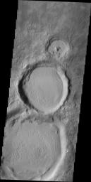 Do you see what I see in this image from NASA's Mars Odyssey spacecraft? These three side-by-side craters increase in size toward the bottom of the image. Looks like a snowman, only his eyes are missing.