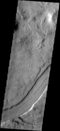 This image captured by NASA's 2001 Mars Odyssey spacecraft shows a small section of Reull Vallis.