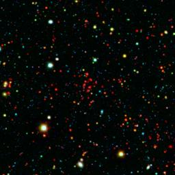 The collection of red dots seen here show one of several very distant galaxy clusters discovered by combining ground-based optical data from the NOAO's Kitt Peak National Observatory with infrared data from NASA's Spitzer Space Telescope.
