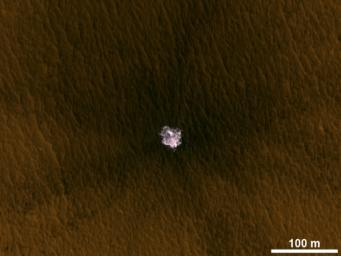 The image is an excerpt from an observation from NASA's Mars Reconnaissance Orbiter showing a meteorite impact that excavated this crater on Mars exposed bright ice that had been hidden just beneath the surface at this location.