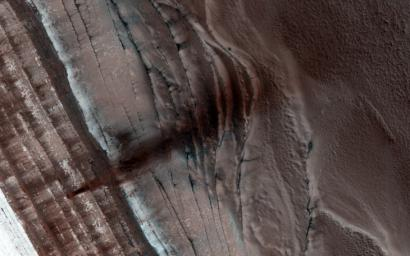 The North Polar region of Mars is capped with layers of water ice and dust, called the 'polar layered deposits.' This permanent polar cap is covered in the winter with a layer of seasonal carbon dioxide ice as seen by NASA's Mars Reconnaissance Orbiter.