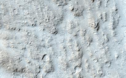 This particular area, called Mangala Valles and located near the Tharsis region, may be an example of the action of liquid water in the ancient Martian past. This image is from NASA's Mars Reconnaissance Orbiter.