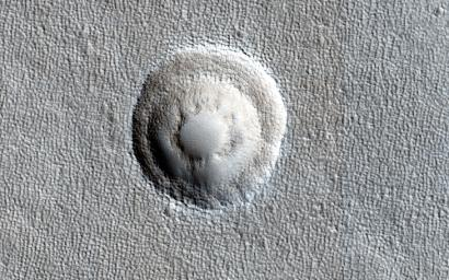 Small impact craters usually have simple bowl shapes; however, when the target material has different layers of different strength, then more complicated crater shapes can emerge as shown in image captured by NASA's Mars Reconnaissance Orbiter.