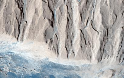 Scientist hypothesize that a lake of liquid water once filled Gale crater, and the layers in the mound formed as sediment settled down through the water to the bottom of the lake in this image from NASA's Mars Reconnaissance Orbiter.