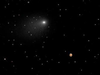 This synthesized composite of NASA Hubble Space Telescope images captures the positions of comet Siding Spring and Mars in a never-before-seen close passage of a comet by the Red Planet.