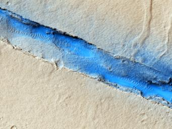 The linearity of the volcanic vent shown in this image observed by NASA's Mars Reconnaissance Orbiter, in conjunction with evidence of lava flow from the vent, suggests control by combined volcano-tectonic processes.