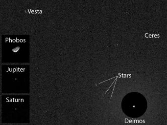 NASA's Curiosity Mars rover has caught the first image of asteroids taken from the surface of Mars. The image includes two asteroids, Ceres and Vesta. This version includes Mars' moon Deimos.