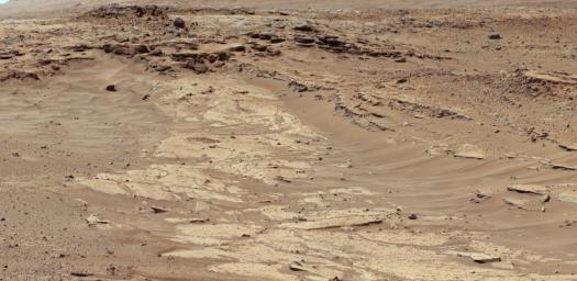 Sandstone layers with varying resistance to erosion are evident in this Martian scene recorded by the Mast Camera on NASA's Curiosity Mars rover on Feb. 25, 2014, about one-quarter mile (about 400 meters) from a planned waypoint called