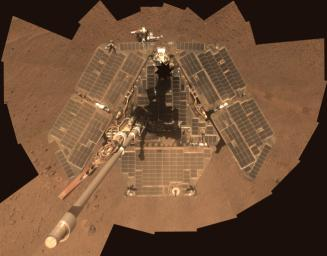 A self-portrait of NASA's Mars Exploration Rover Opportunity taken by the rover's panoramic camera (Pancam) in late March 2014 shows effects of recent winds removing much of the dust from the rover's solar arrays.