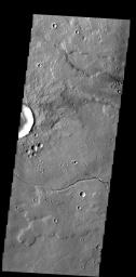 The small channel and lava flows in this image NASA's 2001 Mars Odyssey spacecraft are located northeast of Olympus Mons.