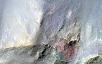 This image covers a 26-kilometer-wide impact crater northeast of the Hellas impact basin as observed by NASA's Mars Reconnaissance Orbiter.