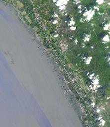 This image from NASA's Terra spacecraft shows the Bangladeshi coast north of Chittagong, where ships from around the world are beached and dismantled.