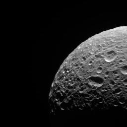 In addition to being evidence of past impacts, craters can serve another valuable scientific purpose. Counting the number of craters in an area, can estimate the age of the terrain. NASA's Cassini orbiter looks toward the trailing hemisphere of Mimas.