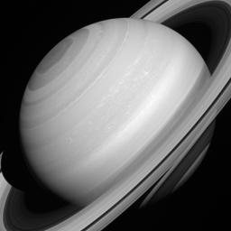 Although solid-looking in many images, NASA's Cassini orbiter shows that Saturn's rings are actually translucent. In this picture, we can glimpse the shadow of the rings on the planet through the A and C rings themselves, towards the lower right corner.