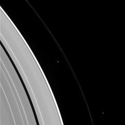 Pandora, Prometheus, and Pan, seen here, from right to left, also appear to be holding some sort of convention in this image from NASA's Cassini spacecraft.