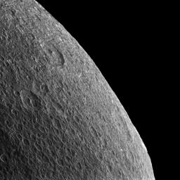 Rhea's horizon is slightly irregular and battered by craters, so thoughts inevitably turn towards the forces that shape these icy worlds. This image is from NASA's Cassini spacecraft.