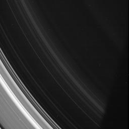 In this image from NASA's Cassini spacecraft, the spiral structures in the D ring are on display, although it is so thin as to be barely noticeable compared to the rest of the ring system.