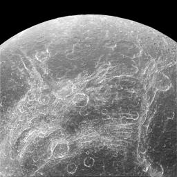 Some parts of Dione's surface are covered by linear features, called chasmata, which provide dramatic contrast to the round impact craters that typically cover moons. This image was captured by NASA's Cassini spacecraft.