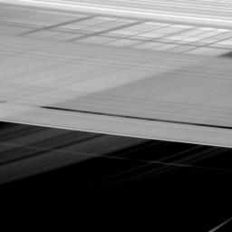 At first glance, Saturn's rings appear to be intersecting themselves in an impossible way. In actuality, this view from NASA's Cassini spacecraft shows the rings in front of the planet, upon which the shadow of the rings is cast.