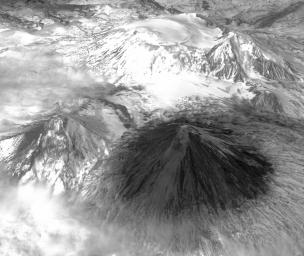 Winter still grips the volcanoes on Russia's Kamchatka peninsula. NASA's Terra spacecraft acquired this image showing the mantle of white, disturbed by dark ash entirely covering Sheveluch volcano from recent eruptions.