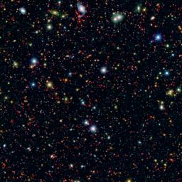 Millions of galaxies populate the patch of sky known as the COSMOS field, short for Cosmic Evolution Survey, a portion of which is shown here. Even the smallest dots in this image are galaxies, some up to 12 billion light-years away.