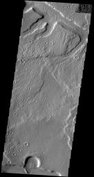 This image captured by NASA's 2001 Mars Odyssey spacecraft shows part of one of the numerous unnamed channels that dissect the northern margin of Arabia Terra.