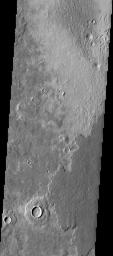 This image captured by NASA's 2001 Mars Odyssey spacecraft shows layering in the plains that comprise Utopia Planitia.