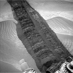 This image, taken on Aug. 4, 2014, from the Navigation Camera on NASA's Curiosity Mars rover shows wheel tracks printed by the rover as it drove on the sandy floor of a lowland called 'Hidden Valley' on the route toward Mount Sharp.