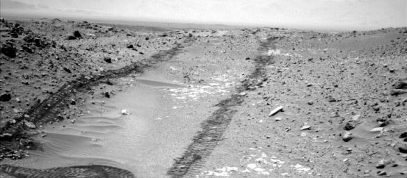 In this image from NASA's Curiosity Mars rover looking up the ramp at the northeastern end of 'Hidden Valley,' a pale outcrop including drilling target 'Bonanza King' is at the center of the scene.