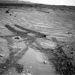 This image from NASA's Curiosity Mars rover looks down the ramp at the northeastern end of 'Hidden Valley' and across the sandy-floored valley to lower slopes of Mount Sharp on the horizon.