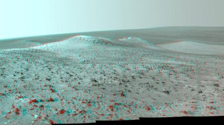 This stereo vista from NASA's Mars Rover Opportunity shows 'Wdowiak Ridge,' from left foreground to center, as part of a northward look. You will need 3-D glasses to view this image.