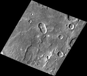 At an Angle. This image NASA's MESSENGER features an elongated impact crater north of Rembrandt impact basin. This crater was most likely formed by a oblique impact which created the crater's distinct elongated shape and central peak.