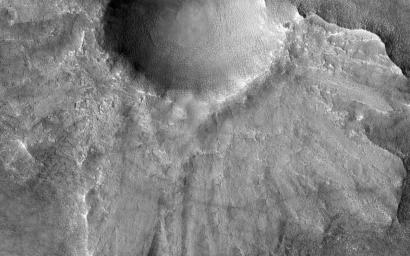 This image from NASA's Mars Reconnaissance Orbiter shows what is termed a pedestal crater, so-called because the level of the surface adjacent to the crater is elevated relative to the surface of the surrounding terrain.