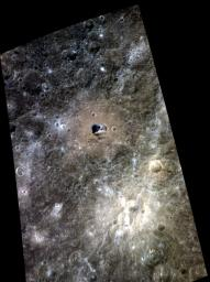 Hemingway crater is seen in this color view of Mercury's surface as seen by NASA's MESSENGER spacecraft. Hemingway is the 130-km (81-mile) diameter crater with a relatively brown floor and small patch of dark blue in its center.