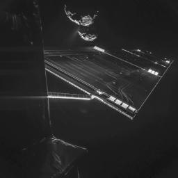 A composite image from a camera on ESA's Rosetta mission's Philae comet lander shows a solar array, with comet 67P/Churyumov-Gerasimenko in the background.