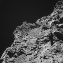 Some relatively rough terrain on the nucleus of comet 67P/Churyumov-Gerasimenko appears in this image taken by the navigation camera on the European Space Agency's Rosetta spacecraft in the second half of October 2014.