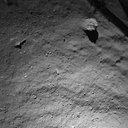 This image was taken by the Philae lander of the European Space Agency's Rosetta mission when it was about 130 feet (40 meters) above the surface of comet 67P/Churyumov-Gerasimenko during descent to the surface on Nov. 12, 2014.