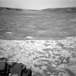 This northeast-facing view from the lower edge of the pale 'Pahrump Hills' outcrop at the base of Mount Sharp includes wind-sculpted ripples of sand and dust in the middle ground. It was taken by Curiosity's Navcam on Nov. 13, 2014.