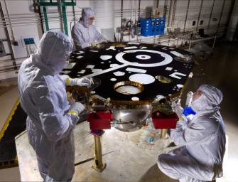 Technicians in a Lockheed Martin clean room near Denver prepare NASA's InSight Mars lander for propulsion proof and leak testing on Oct. 31, 2014. Following the test, the lander was moved to another clean room for start of the mission's ATLO phase.