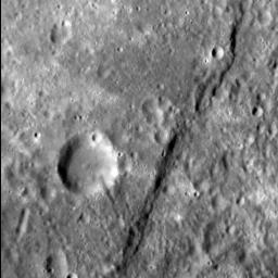 The cliff-like feature crossing this image from NASA's MESSENGER spacecraft from top to bottom is one of Mercury's famed lobate scarps, and is called Pourquoi-Pas Rupes.