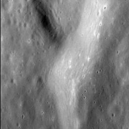 This image from NASA's MESSENGER spacecraft shows the fine texture on the inner wall of an unnamed impact basin 100 km (62 mi.) in diameter, situated immediately west of the larger Dali basin.