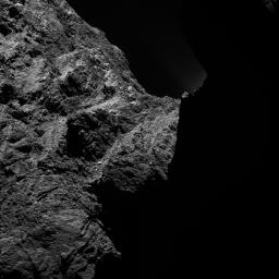 This image of comet 67P/Churyumov-Gerasimenko was obtained on October 30, 2014 by the OSIRIS scientific imaging system on the Rosetta spacecraft. The right half is obscured by darkness.