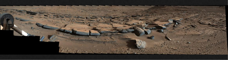 On March 25, 2014, view from the Mastcam on NASA's Curiosity Mars rover looks southward at the Kimberley waypoint. Multiple sandstone beds show systematic inclination to the south suggesting progressive build-out of delta sediments.