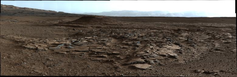 This image from Curiosity's Mastcam looks to the west of a waypoint on the rover's route to Mount Sharp. The mountain lies to the left of the scene.
