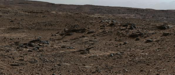 This image shows inclined beds characteristic of delta deposits where a stream entered a lake, but at a higher elevation and farther south than other delta deposits north of Mount Sharp.