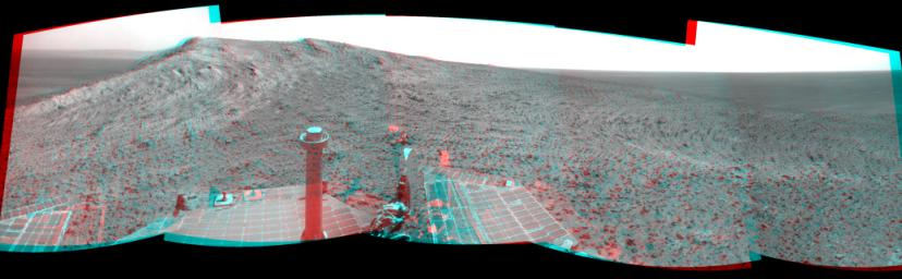 NASA's Mars Exploration Rover Opportunity recorded this view of the summit of 'Cape Tribulation,' on the western rim of Endeavour Crater on the day before the rover drove to the top. You need 3D glasses to view this image.